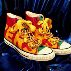 high-top converse all-stars size red green and yellow, laced with golden chains, and large yellow shoe strings. new in-box. Yellow Converse, Yellow Shoes, Converse Men, Converse All Star, Star Wars, Red Green, Buy Now, High Tops, Shoes Sneakers