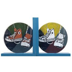 Furnistar Set of 2 Decorative Wood Child Teen Sneakers Bookends. This set of decorative wood bookends looks wonderful in a child or teen's bedroom or playroom. Each piece features a circular image of a pair of sneakers (one pair red the other white) on a blue base. These fun colorful bookends are sure to become a much-loved addition to their collection of books and make a great birthday or holiday gift.