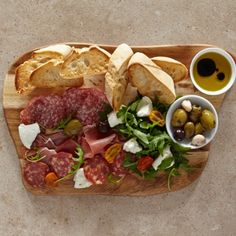 Antipasto sharing starter served on a wooden board
