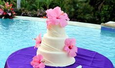 Flowers of Jamaica real pink hibiscus wedding cake for a destination wedding in Jamaica