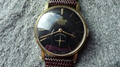 Cornavin Swiss Watch  Black dial with golden markers and golden Hands    Separate second hand yes seperate window  Incabloc yes  Antimagnetic yes