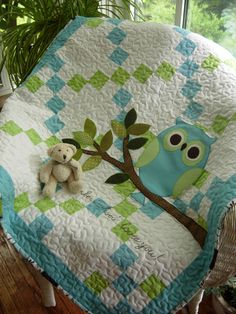 Pretty pastel shades of aqua and green with swirls and dots for a sweet baby boy. Machine blanket stitched appliqued owl on a branch of leaves with hand embroidery across the bottom that reads Remember Whooo Loves You! is so cute for the owl lover in all of us. Quilt is machine
