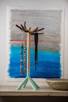 Wood necklace rack, practical and stable. The combination of raw wood, natural branches and moderate paint, highlights the jewelry uniqueness.