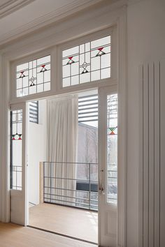 Minimal interior with simple geometric stained glass windows via Dezeen