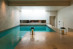 Basement pool at Bedford Gardens house. Nash Baker Architects created a luxurious family home in Notting Hill, behind a historic 19th c. façade, featuring a dramatic helical staircase, a spacious basement, pool & home cinema.
