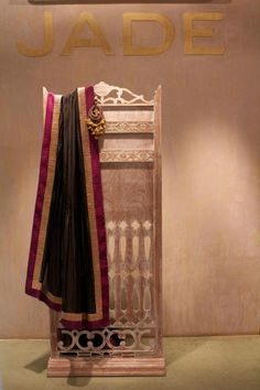 Practice your 'thank you's,as you are sure to get many compliments in this black and pink sarees.