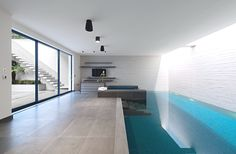 Indoor pool design by SHH for project West London House Indoor Swimming Pools, Swimming Pool Designs, Lap Swimming, Moderne Pools, Basement Pool, London House, Pool Houses, Home Design, Interior Design