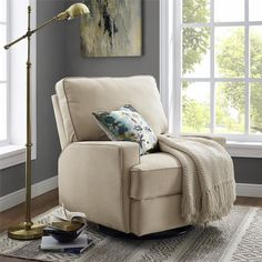 A swivel design pairs with a streamlined silhouette to round out this gliding recliner. Use it to complement a traditional seating group or to level out a bold boho arrangement.