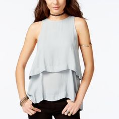 🎉HP Work Week🎉💜 Free People Tiered Cutout Top Polyester. Crew neck.  Button Loop Closure at back.  Sleeveless.  Tiered styling.  Cutout at back.  Hits below hip.  Color Soft Green. Free People Tops