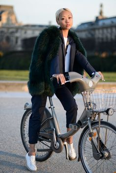 bike chic with that fab fur. #VanessaHong in Paris.  #TheHautePursuit