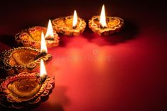 Photo about Happy Diwali - Clay Diya lamps lit during Dipavali, Hindu festival of lights celebration. Image of festival, background, celebration - 130195327 Happy Diwali Pictures, Diwali Photos, Candle Lamp, Candles, Hindu Festival Of Lights, Diwali Poster, Happy Diwali Wallpapers, Diwali Photography, Diya Lamp