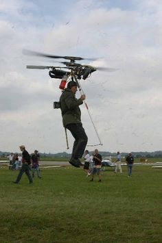 Backpack helicopter, using small rockets at the tips of the blades for propulsion.