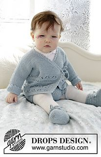 The set consists of: Knitted baby jacket and slippers with lace pattern and garter stitch. Sizes premature - 4 years. The set is worked in DROPS BabyMerino.