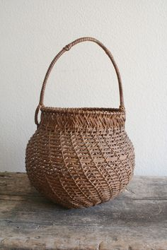 Vintage hand woven egg basket, primitive style, no staples, no wire. Split grass reed with a wonderful patina.