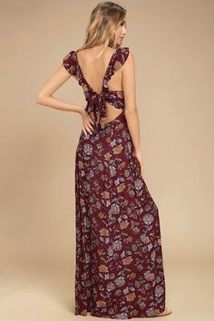 Enjoy life's little joys with the Simple Pleasure Burgundy Floral Print Maxi Dress! Ruffled straps support a seamed bodice, empire waist, and flowing maxi skirt, all composed of woven poly with a lovely yellow, mauve, and light blue floral print. Tying open back. Hidden back zipper/clasp.