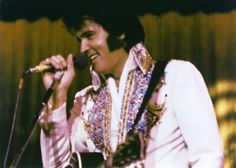 """Lake Tahoe, NV. October 11th 1974 opening show. This is the very first time Elvis wore the """" King Of Spades """" jumpsuit. Many fans thought for a long time that Elvis had a brand new jumpsuit in October 1976 tour when he came on stage with it. Elvis never used any black guitar on stage after the July '75 tour so the above picture can't be from 1975 onwards."""