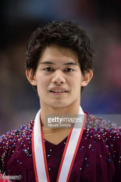 Takahiko Kozuka of Japan poses with medal in the men's single victory ceremony during All Japan Figure Skating Championships at Saitama Super Arena on December 22, 2013 in Saitama, Japan.