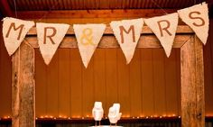 Rustic wedding DIY Mr & Mrs sign and frame above cake table
