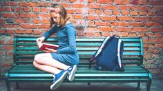 Girl reading on a park bench