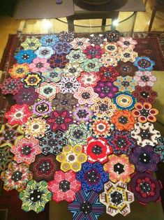 hexie quilt in progress. I may have pinned this before, but I love these fussy cut hexies!