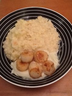 Cauliflower risotto with cauliflower purée and scallops