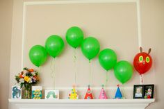 Very Hungry Caterpillar Party. We tied the balloons on a chain so they'd stay in place and put it on the mantle so the kids wouldn't destroy him. Couldn't have been any cuter! But the party wore the hungry caterpillar out because the next day his head drooped low....