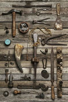 Old tools on wooden wall