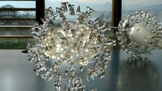British artist Luke Jerram's glass sculptures represent a variety of viruses, such as Smallpox and HIV, and are made to encourage viewers to contemplate the global impact of each disease.