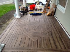 Zuri from Royal Building Products with a compass rose in the middle of the front. Zuri from Royal Building Products with a compass rose in the middle of the front porch. Deck Design, Floor Design, Woodworking Plans, Woodworking Projects, Deck Patterns, Hallway Art, Diy Deck, Home Upgrades, Decks And Porches
