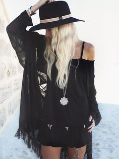Black boho chic fringe cover up over modern hippie cold shoulder shirt. For the BEST Bohemian fashion style FOLLOW https://www.pinterest.com/happygolicky/the-best-boho-chic-fashion-bohemian-jewelry-gypsy-/ now