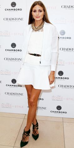 OLIVIA PALERMO In Melbourne, Australia, Olivia Palermo attended a launch in an all-white ensemble, shrugging a mesh jacket over a cut-out top and flippy skirt. She broke up the white with a statement necklace, stacks of gold bracelets, gold belt and forest green strappy pumps.