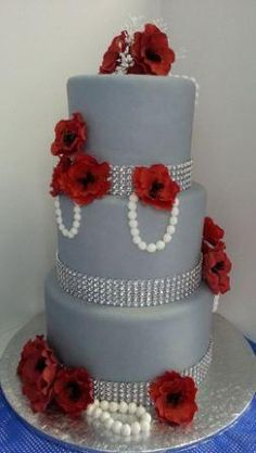 Grey and red Wedding cake with fondant pearls and red fondant flowers.