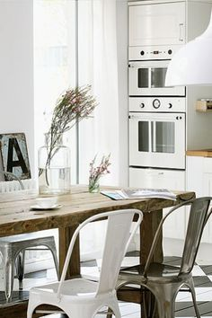 Tolix and wood. Can't help it, I just love white kitchens! So clean and pure