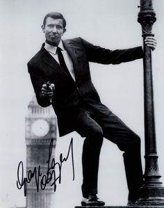 Excellent Promo Shot Of George Lazenby As James Bond MR Lazenby Was James Bond In The 1969 Bond Film On Her Majestys Secret Service Along With Diana Rigg Who Played Tracy 8 X 10 Photo Signed By Georg
