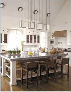 If we could add on to our kitchen, I think we would want something like this. Open, with lots of natural light from windows, and an island in the middle.