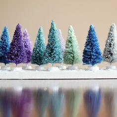 Create this whimsical winter scene with DIY glitter bottle brush trees.