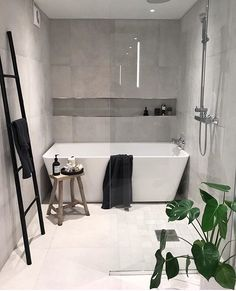 Similar to our bathroom layout. I like it, but need to provide drains so all water drains away, including around bath. I like the wall cut out.