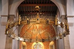 on Sacred DestinationsMedieval Wheel Chandelier Medieval wheel chandelier, the largest and oldest in Europe.  Credit: Holly Hayes Hildesheim Cathedral Germany