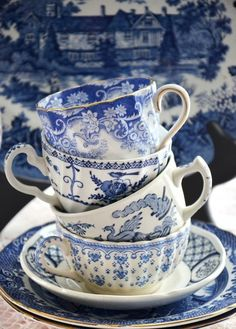 blue and white transferware cups and saucers