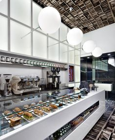 D'espresso Cafe Interior3--- like the glass case and the clean lines