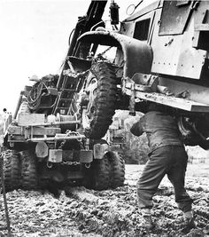 The men of US 3rd Army deal with the mud of Lorraine, France, October 1944.