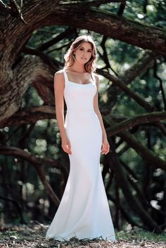 Subtly squared off at the neckline and back, this chic slim-fitting gown is beautifully classic with a vintage appeal.