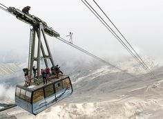Crazy cable walker on Zugspitze Mountain, Germany.