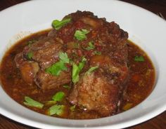 Braised Oxtail with Port - Preparation time:25 minutes  Slow Cooker Size3.5L+  Serves:4  Cooking time:9-10 hours on Low setting