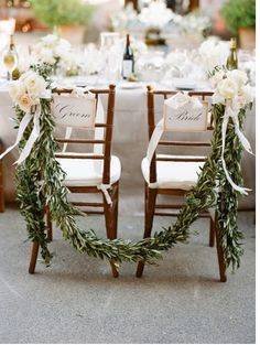 RECEPTION: Bride/groom gold chivari chairs with seeded eucalyptus garland and white flowers.