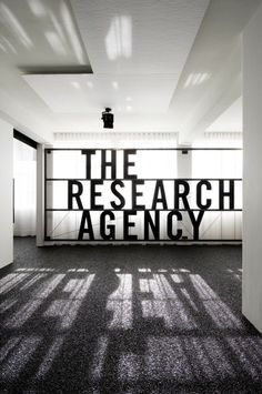 internal billboard reflects light, blocks ugly view and wows clients (The Research Agency by Jose Gutierrez):