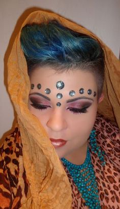 Aqua jewels enhance pretty smokey eyes to create this Indie inspired makeup by Malwina P.