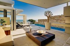 "Looking for a luxury Cape Town vacation villa with ""the best sunsets South Africa has to offer""? Look no further than the beautifully appointed Villa Azure. Camps Bay Cape Town, Cape Town Accommodation, Magazine Deco, Outdoor Fireplace Designs, Custom Fireplace, Modern Mountain Home, Boutique Deco, Rustic Luxe, Desert Homes"