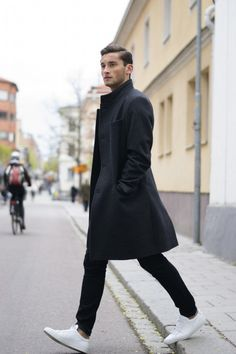 Black Overcoat, Black Jeans, and White Sneakers. Men's Early Fall Winter Street Style Fashion.