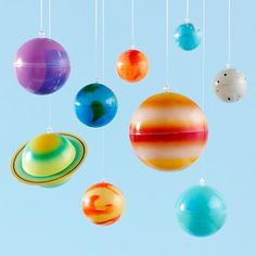 The perfect piece of room décor for the kid that can't get outer space out of their system. Features nine colorful, hanging glow-in-the-dark planets.